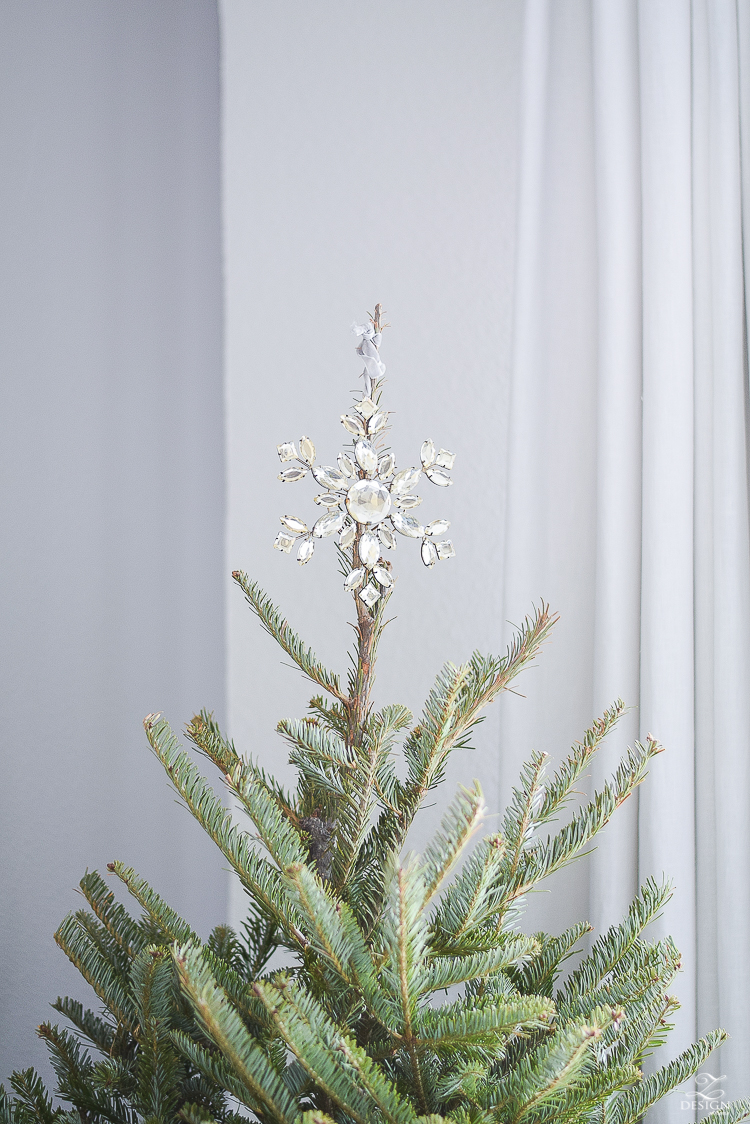 Crystal ornament used as tree topper on a real christmas tree