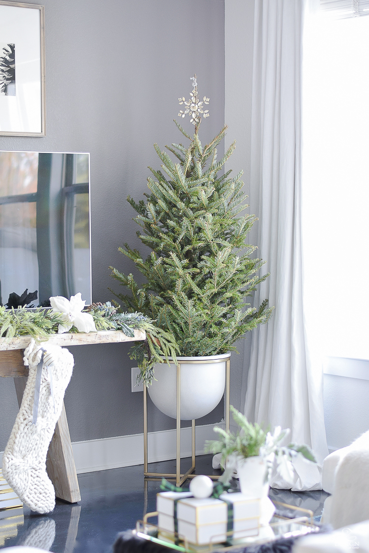 Christmas tree in modern pot with brass legs - Boho glam christmas living room tour