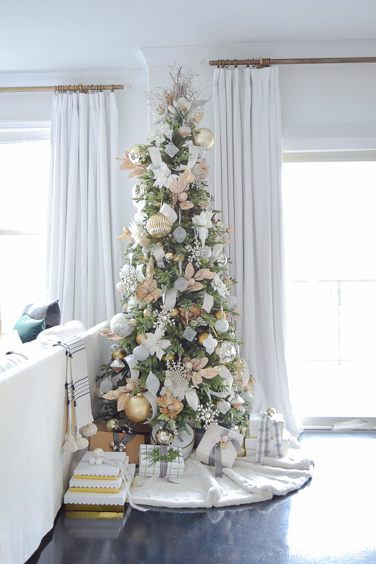 White and gold glam christmas tree in a boho chic Christmas living room tour