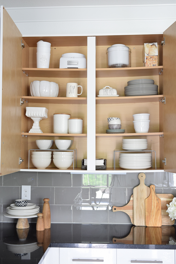 The best way to organize your dishes with cabinet shelf risers