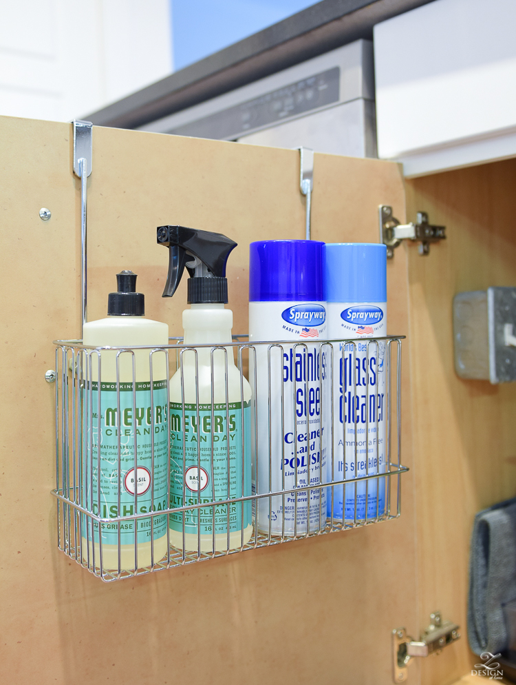 Over the cabinet organizer basket to access items used most to clean the home