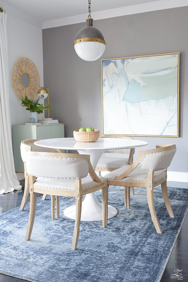 Boho chic dining space with navy distressed rug, whitman pendant and the best knock off tulip table