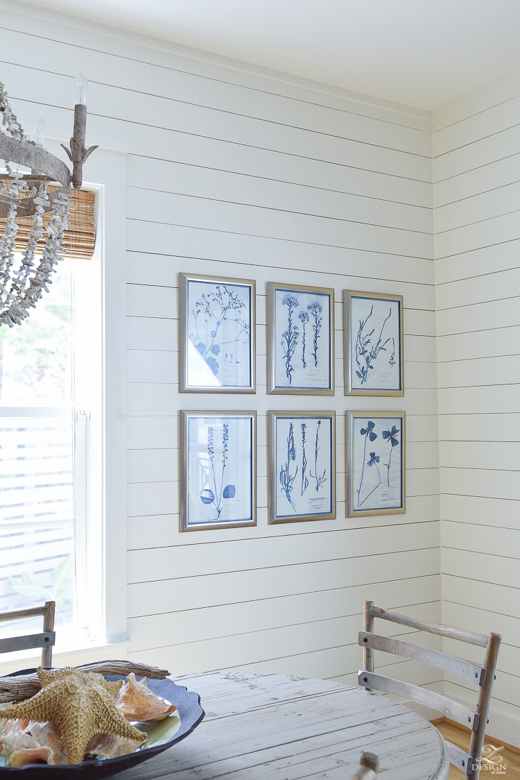 blue and white botanical art prints with silver frame in coastal inspired Florida rental home
