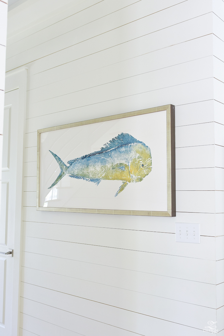 bill fish art in coastal inspired home hung on shiplap