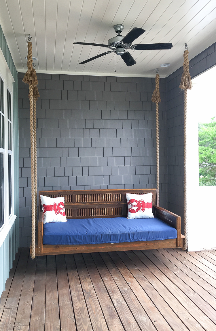 Porch swing daybed suspended by rope - coastal home in 30-A florida for rent