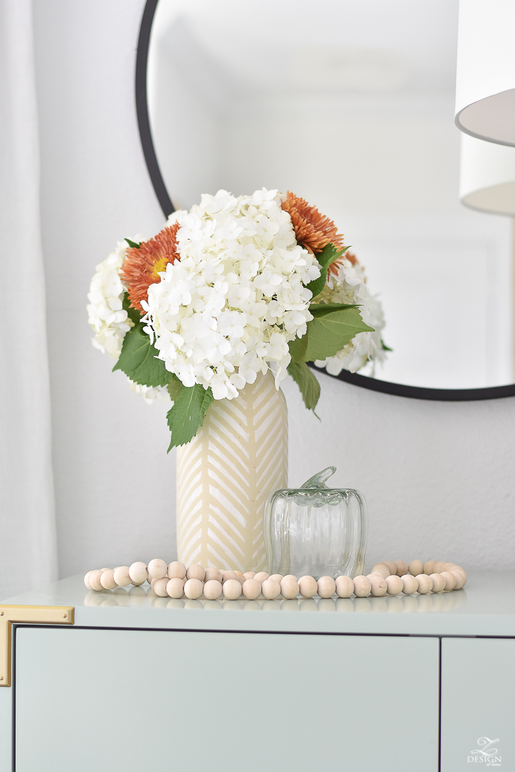 Simple Modern Fall Decorating Ideas - glass pumpkins, hydrangeas in modern vase with mums added