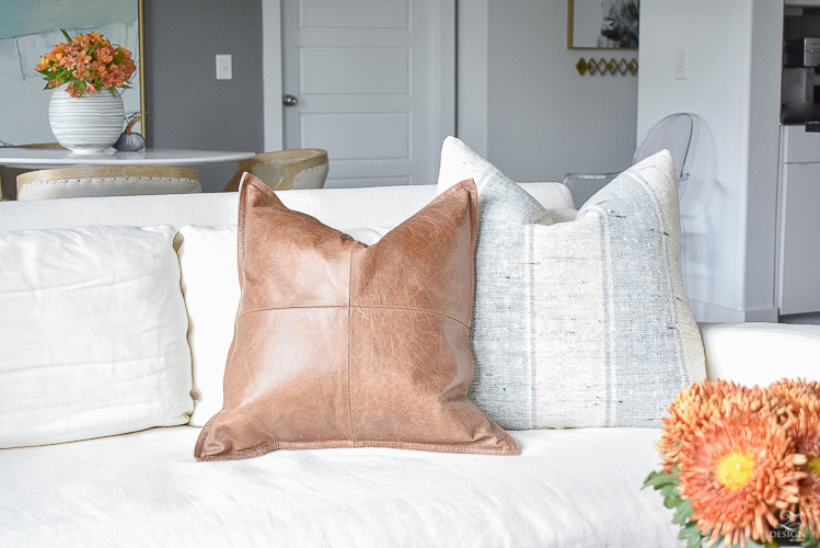 Simple modern fall decorating ideas - leather and grain sack pillows