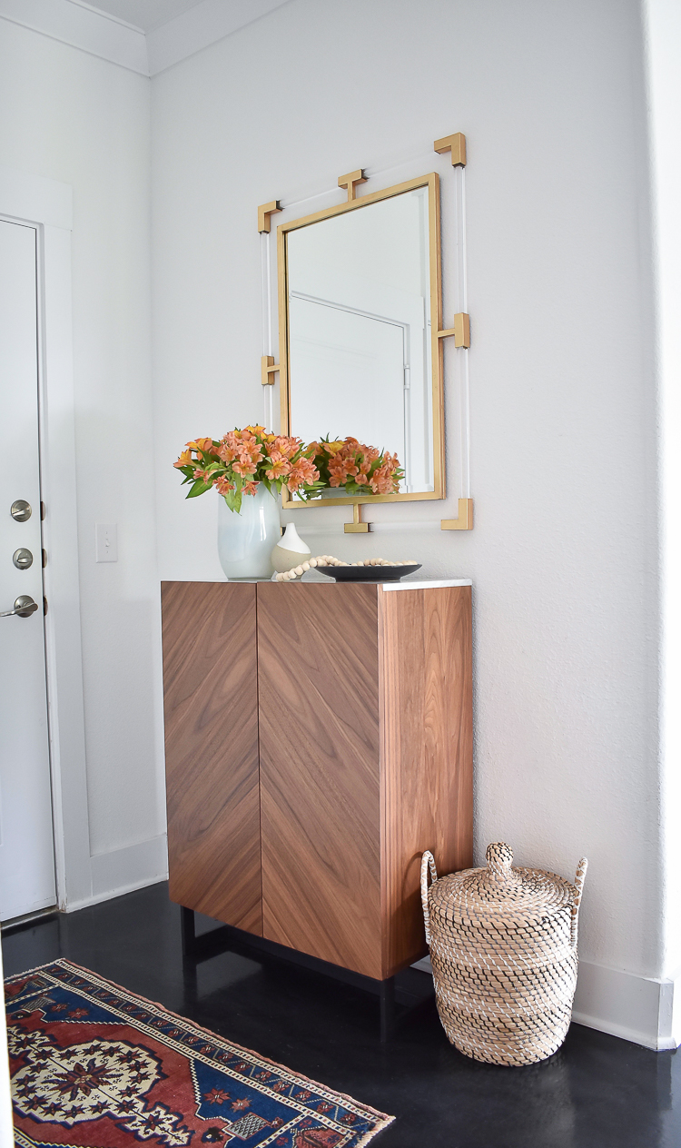 Small Transitional Entry That Packs A Big Punch - How to organize a small entry way, shallow entryway cabinet w/ marble top, brass/gold lucite mirror