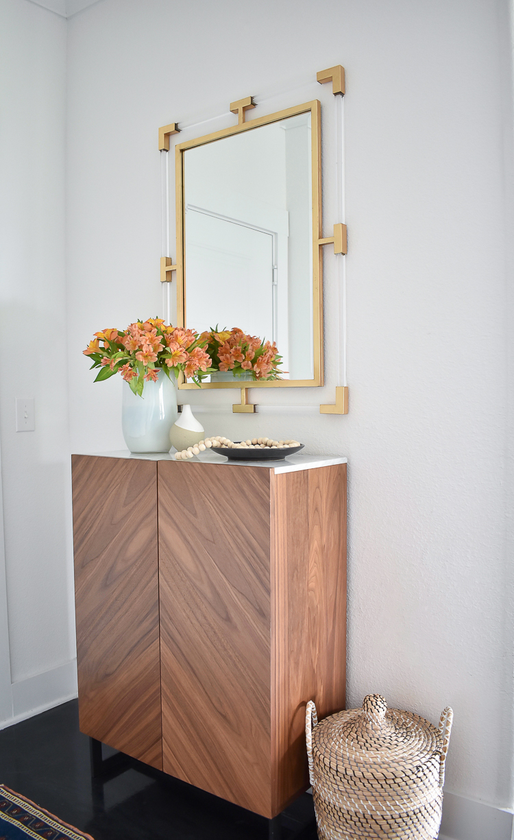 Small Transitional Entry That Packs A Big Punch - Modern entry cabinet with marble top, lucite & gold mirror