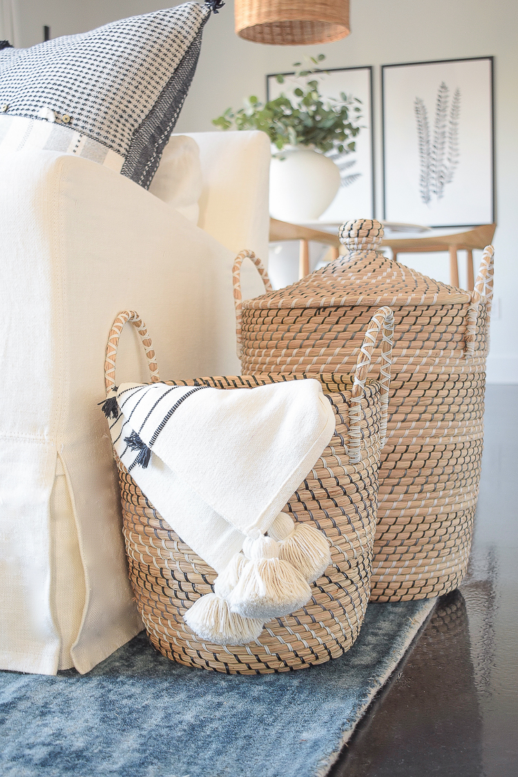 Creating a cozy winter home - tips + tour - lidded baskets with tassel throw