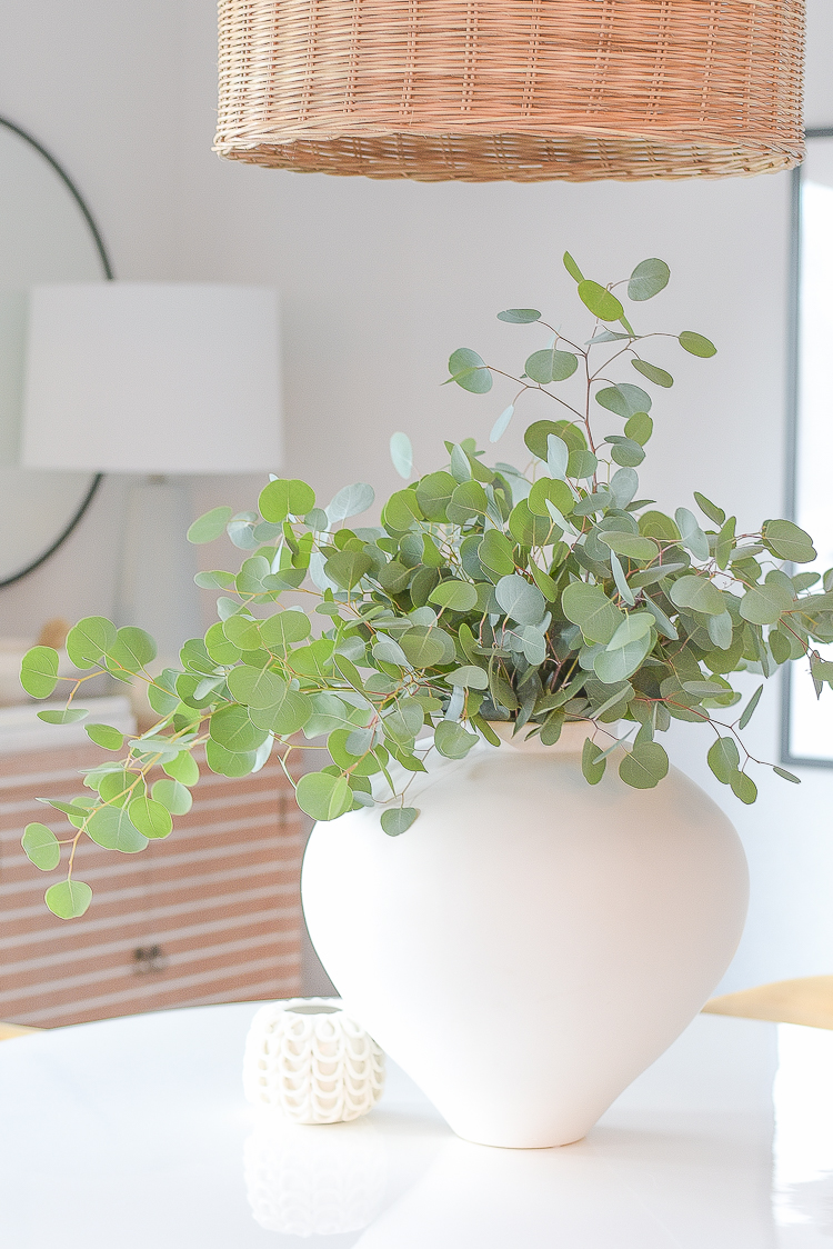 Creating a cozy winter home tour + tips - white urn with eucalyptus