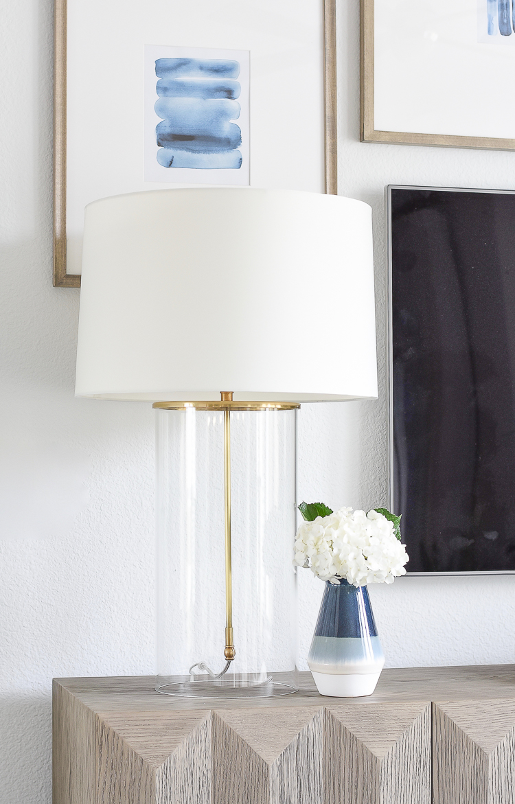 TV gallery wall updates + reveal - glass & brass classic lamp