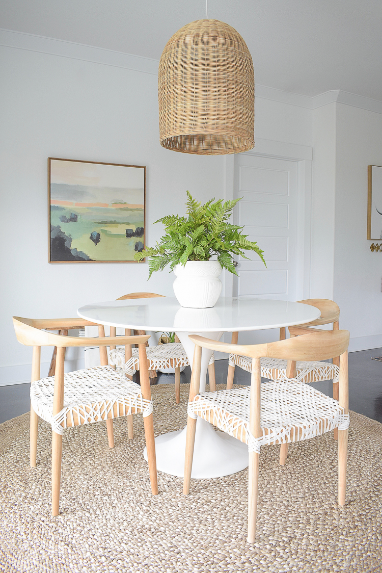 Zdesign At Home Spring Dining Room Tour - Boho chic design w/ basket pendant, tulip table, modern wooden chairs with leather seat