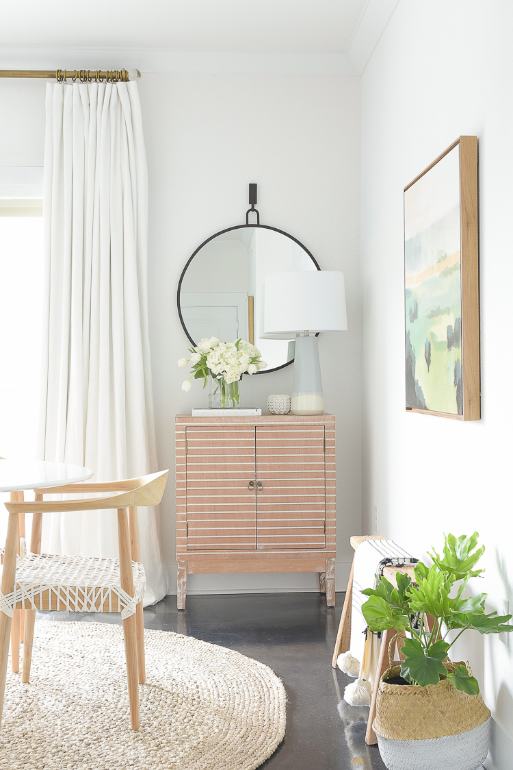ZDesign At Home Spring Dining Room Tour - round black mirror, blue lamp, modern wood bar cabinet
