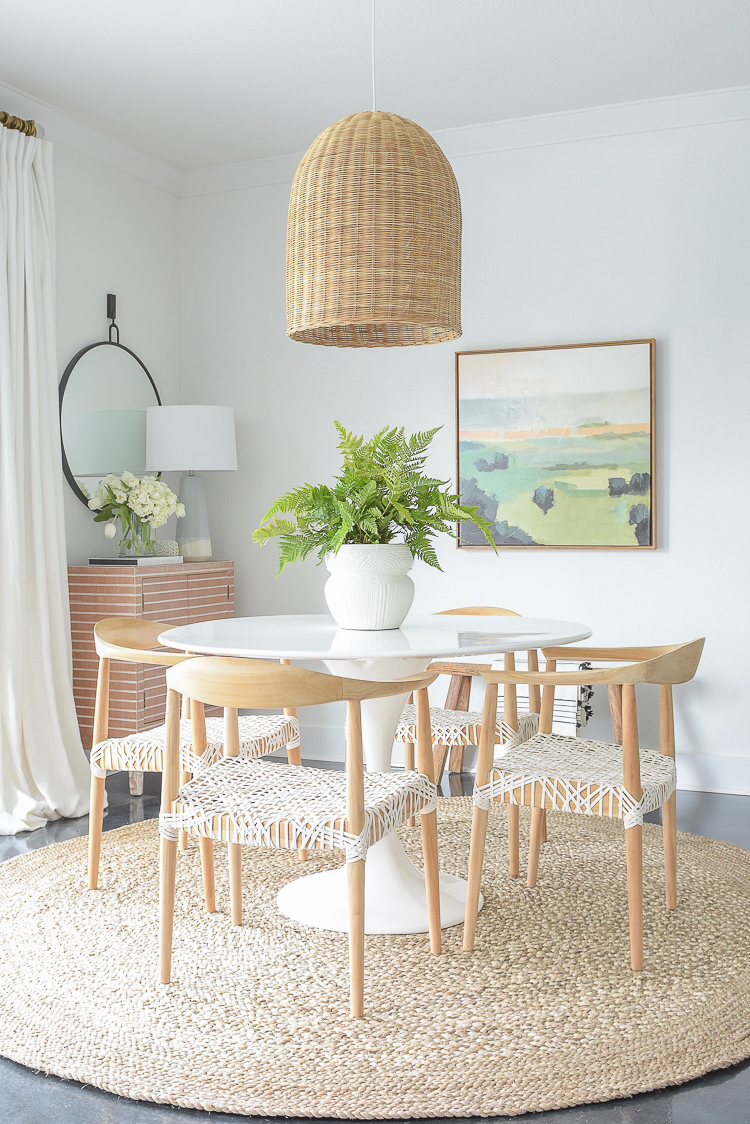 ZDesign At Home Spring Dining Room Tour - Boho Chic Dining Room Design w/ basket pendant, tulip table, round jute rug