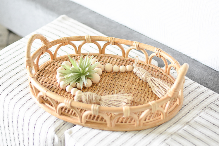 Styled for the season spring tour - rattan textured tray, wooden bead strand with tassels