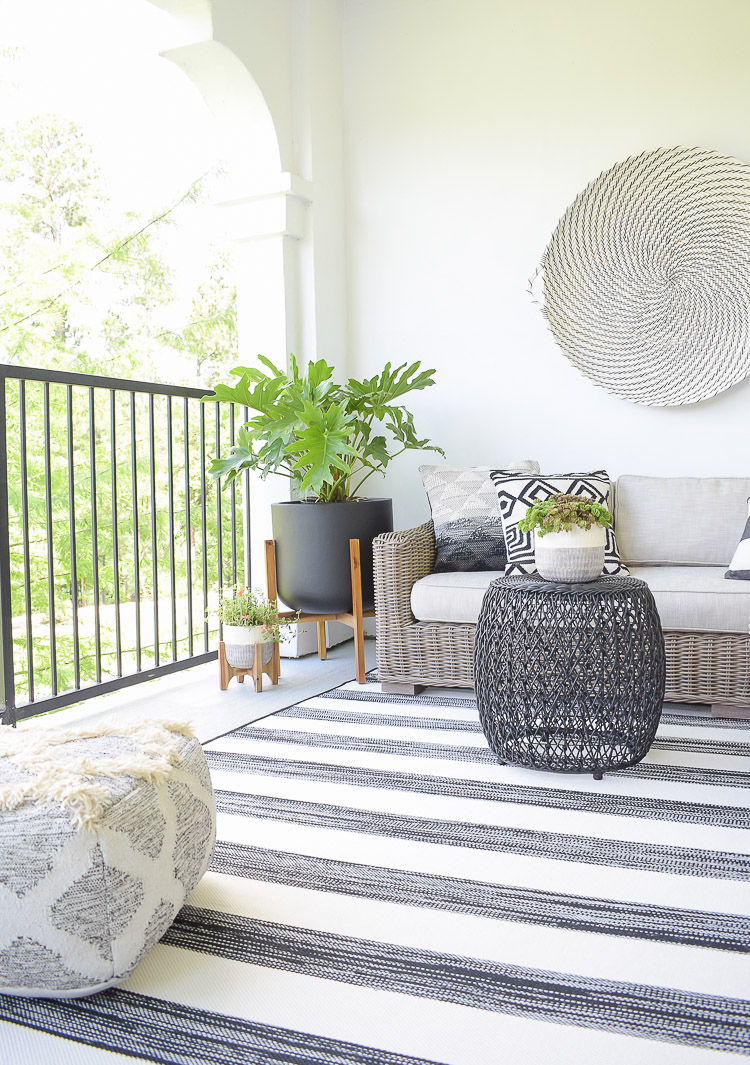 Tips For Creating A Relaxing Outdoor Space This Summer + A Patio Tour - black and white themed porch