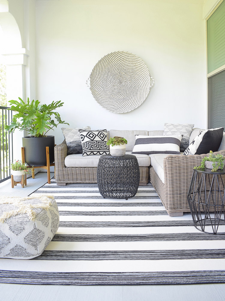 Tips For Creating A Relaxing Outdoor Space This Summer + A Patio Tour - black and white themed patio design