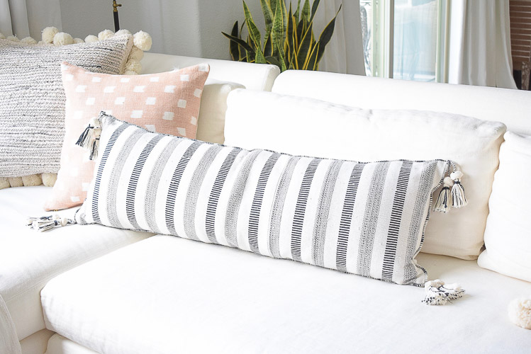 Black and white pom pom striped tassel pillows, summer living room home tour