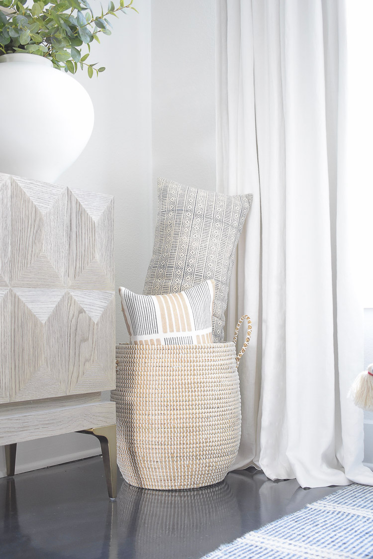 Summer Home Tour - boho pillows in serena and lily lidded white basket