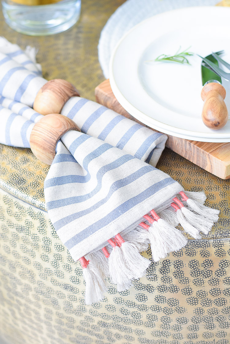 Sustainably sourced tassel striped napkins, olive wood napkin rings
