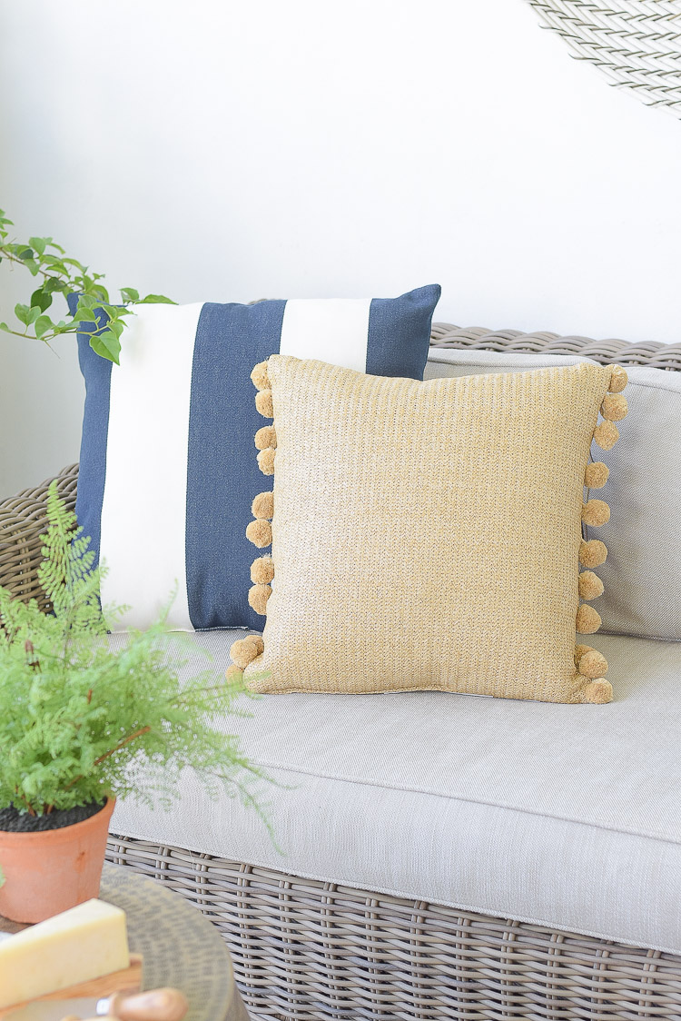 The best sustainable home decor products for outdoor - pom pom pillow, navy white stripe pillow