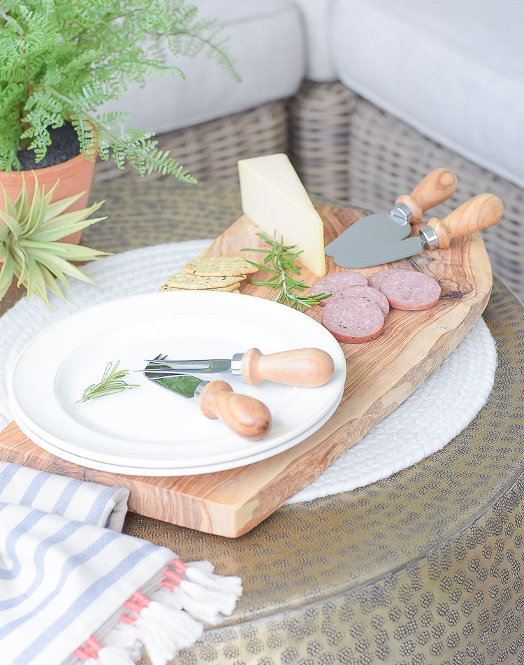 Sustainably sources olive wood cheese board and knives