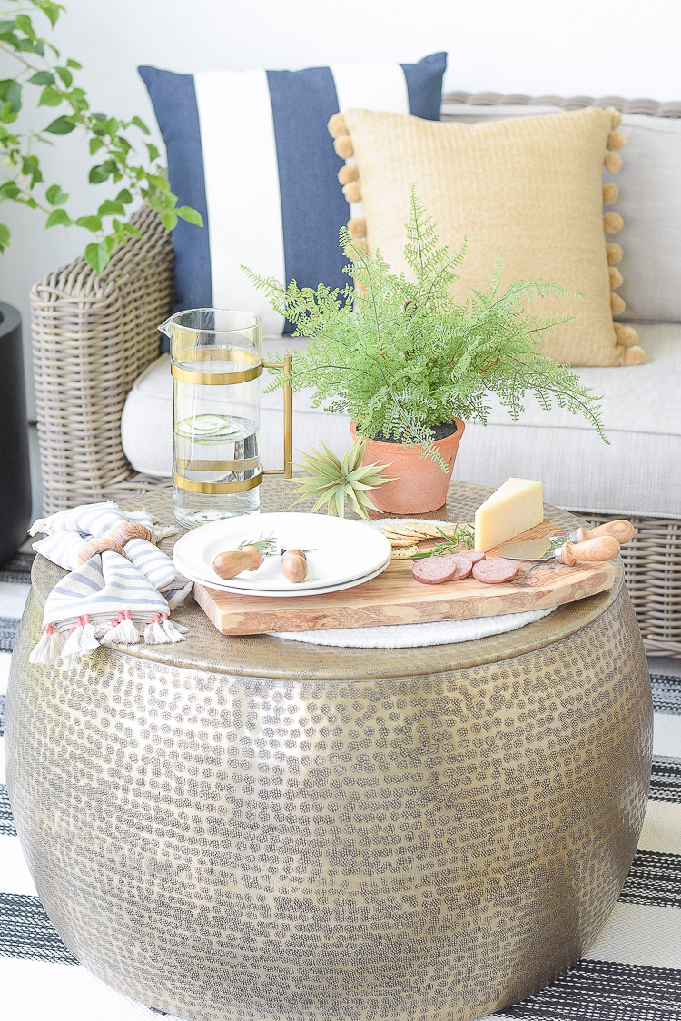 Outdoor sustainably sourced home decor items - cheese board, faux ferns, tassel napkins, olive wood dining accessories