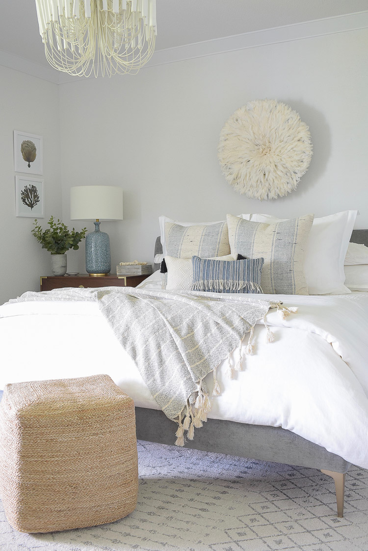 4 Subtle Ways To Add Coastal Decor To Your Home - Blue and White Coastal Inspired Bedroom