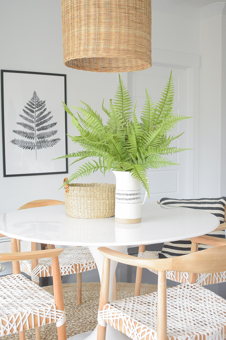 Tips for adding natural summer decor + a dining room tour - beautiful faux fern pics in boho chic vase