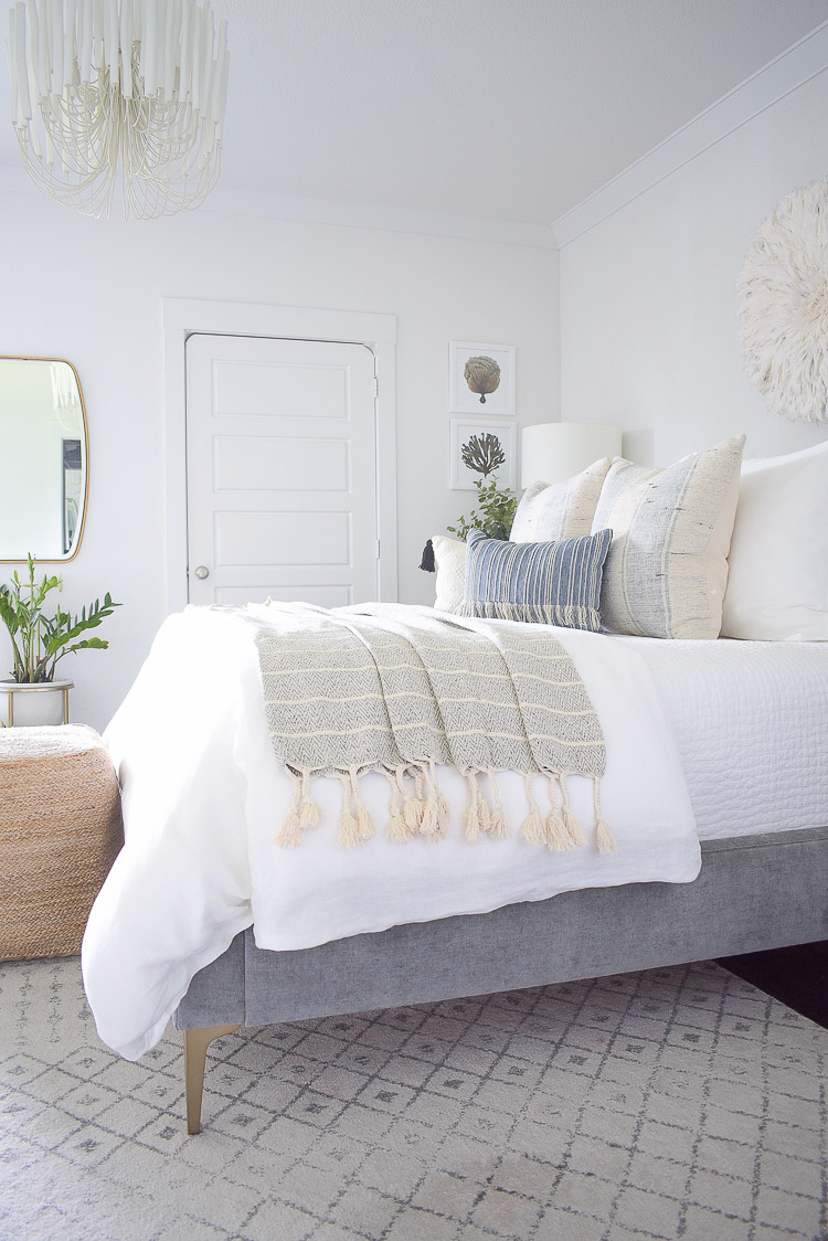 4 Subtle Ways To Add Coastal Decor To Your Home - Coastal Inspired Bedroom in blue and white