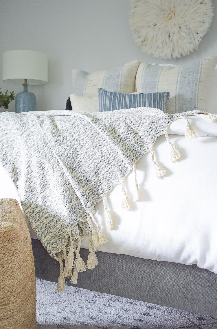 4 Subtle Ways To Add Coastal Decor To Your Home - Coastal Inspired Bedroom - neutral tassel throw with fringe