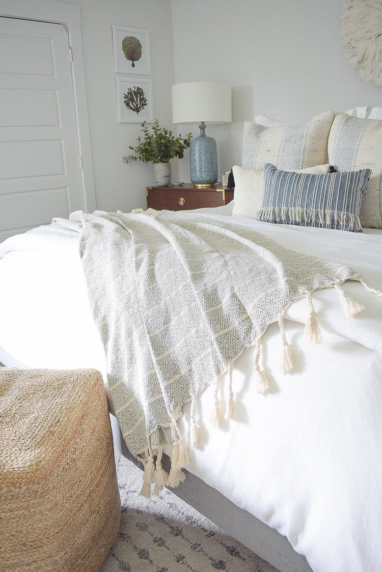 4 Subtle Ways To Add Coastal Decor To Your Home - Coastal Inspired Bedroom - neutral tassel throw with chevron pattern