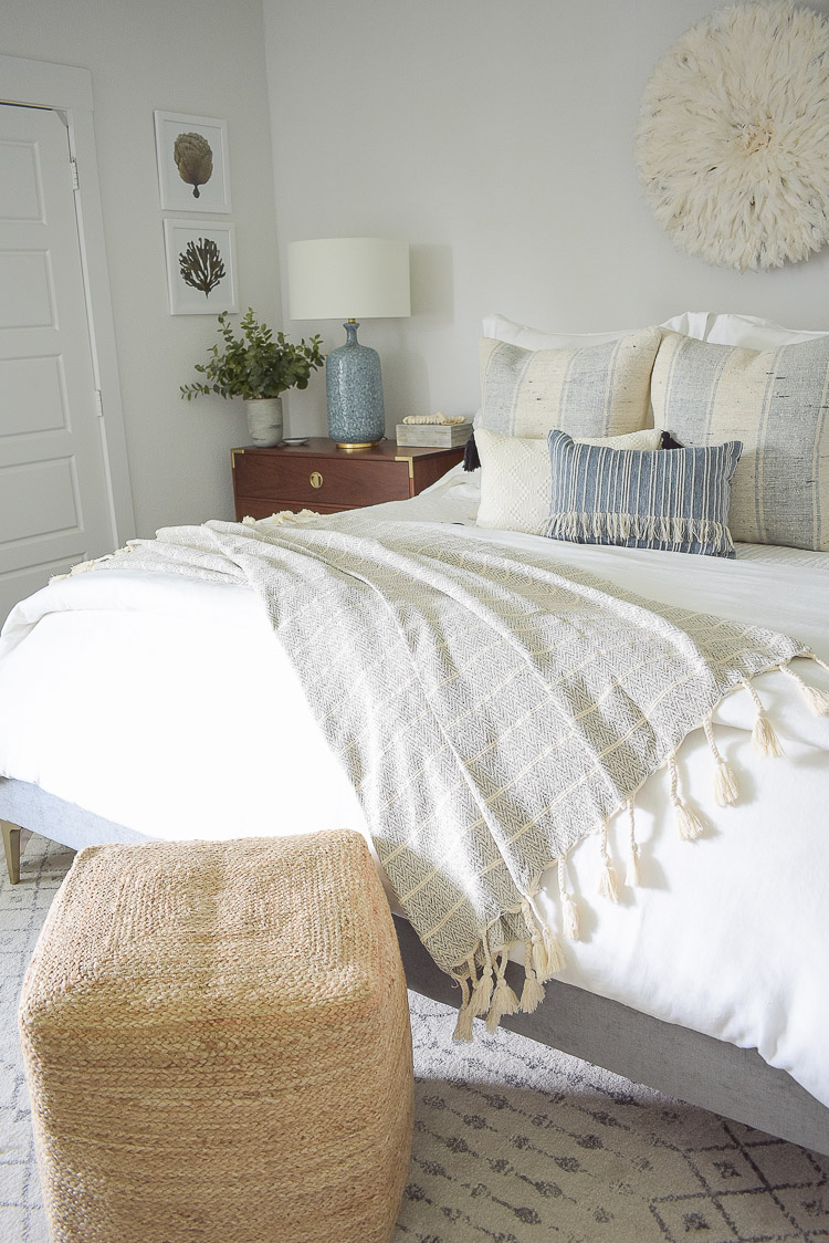 4 Subtle Ways To Add Coastal Decor To Your Home - Coastal Inspired Bedroom - neutral tassel throw in coastal inspired bedroom