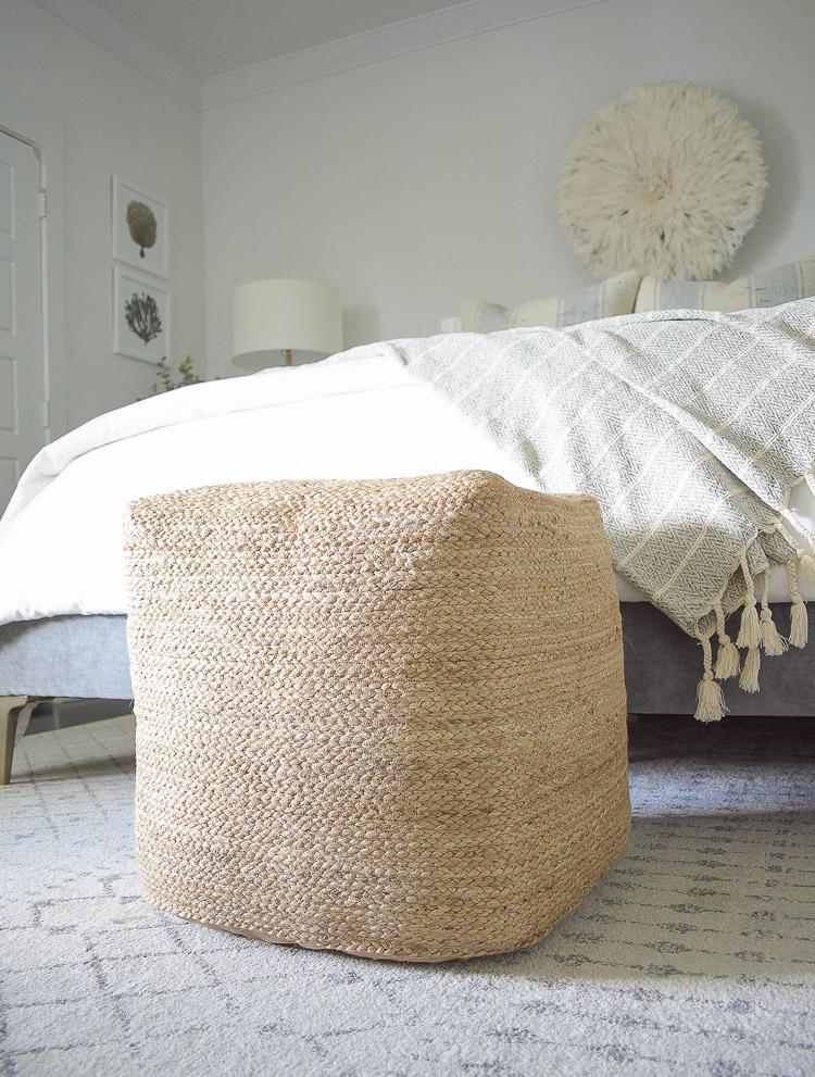 4 Subtle Ways To Add Coastal Decor To Your Home - Coastal Inspired Bedroom - square jute pouf