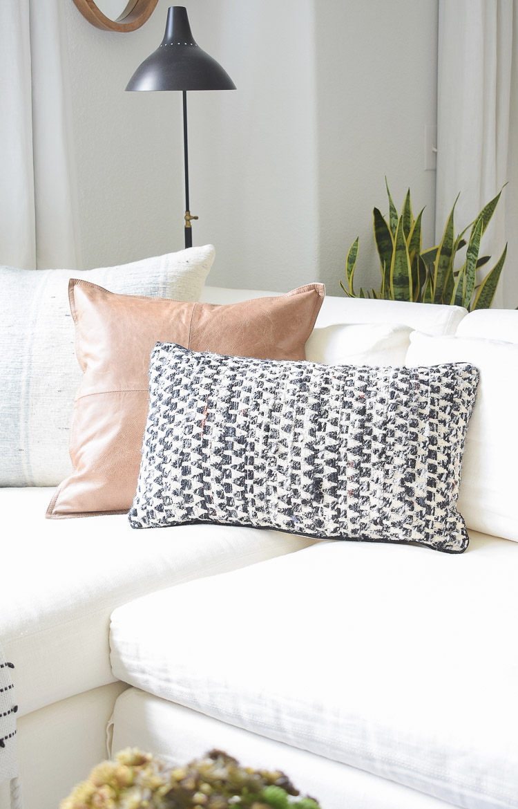 Small space, big style solutions - black and white textured pillows & throws