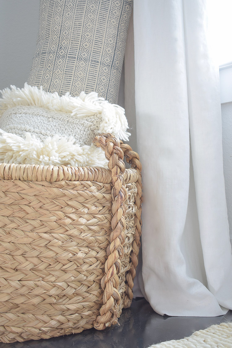 Chunky Wovens for Fall - braided handle basket with pillows and extra throw blankets