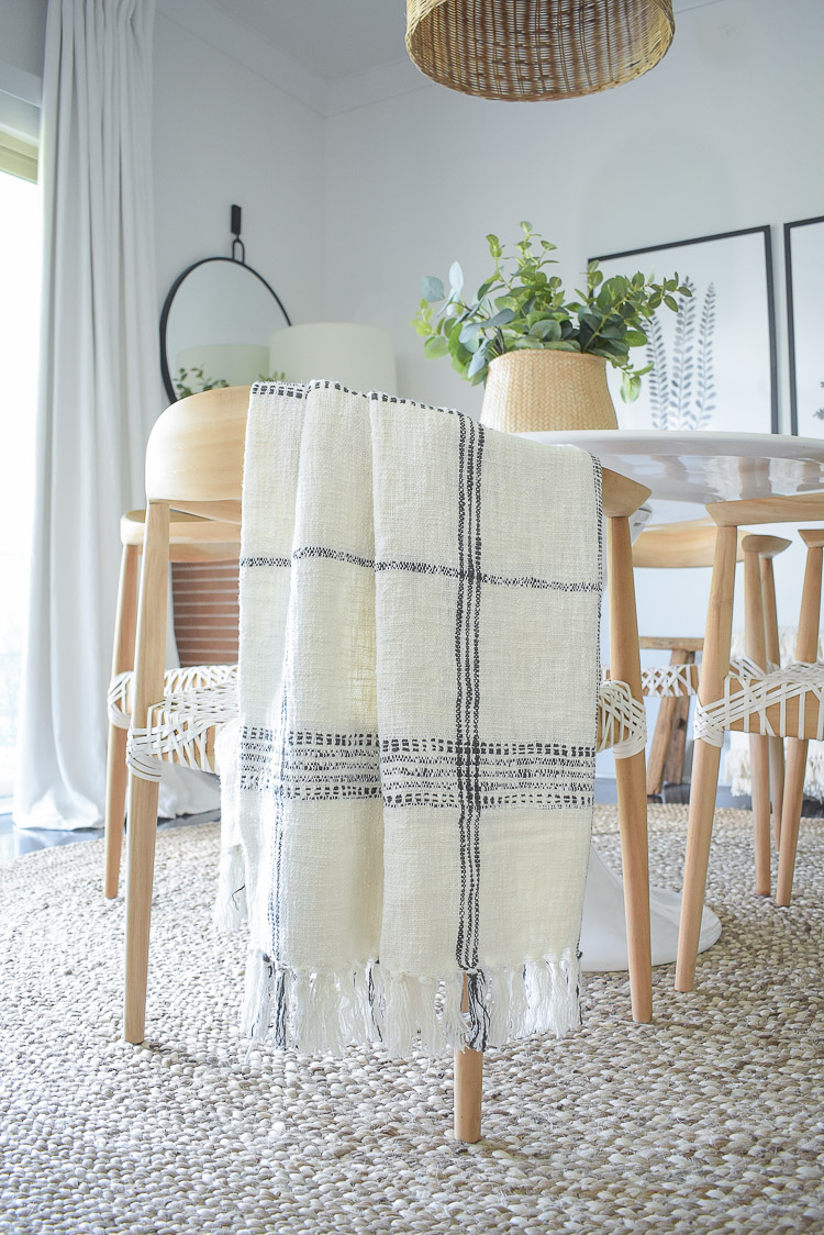 A textured fall home tour - fall dining room tour - plaid window pane throw
