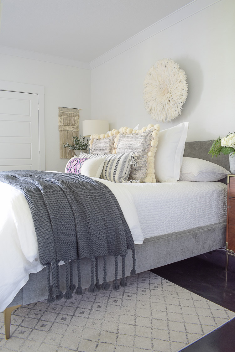 Fall bedroom tour with pom pom pillows, chunky gray tassel throw and white bedding