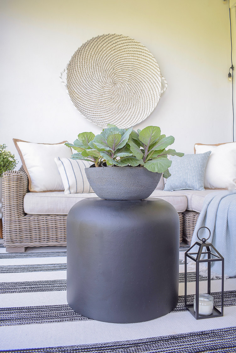 A Cozy Modern Fall Patio Tour - Flowering Kale in Faux Cement Pot