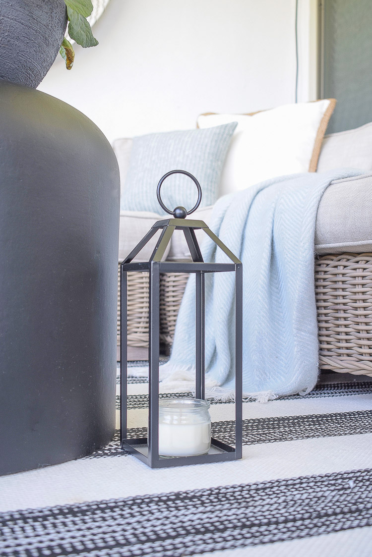 A Cozy Modern Fall Patio Tour - black outdoor lantern for fall