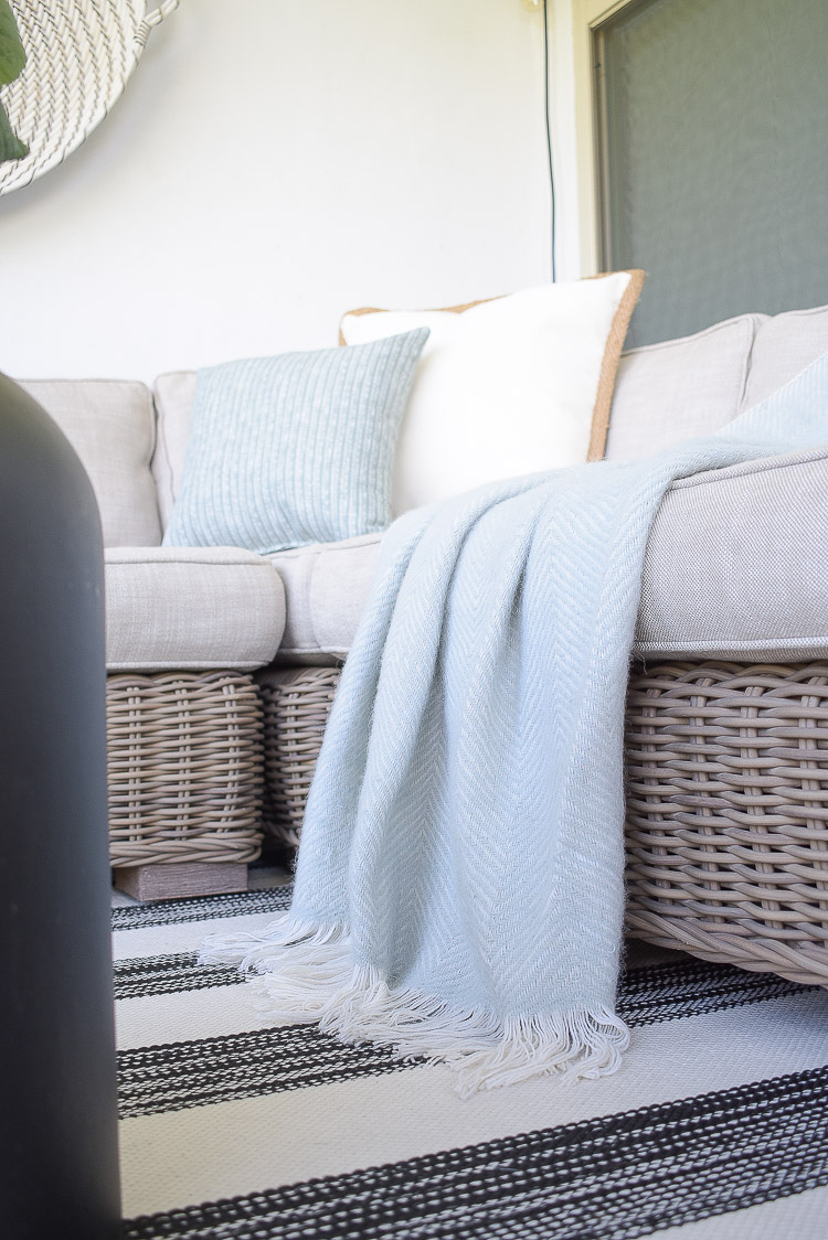 A Cozy Modern Fall Patio Tour - soft herringbone throw in gray