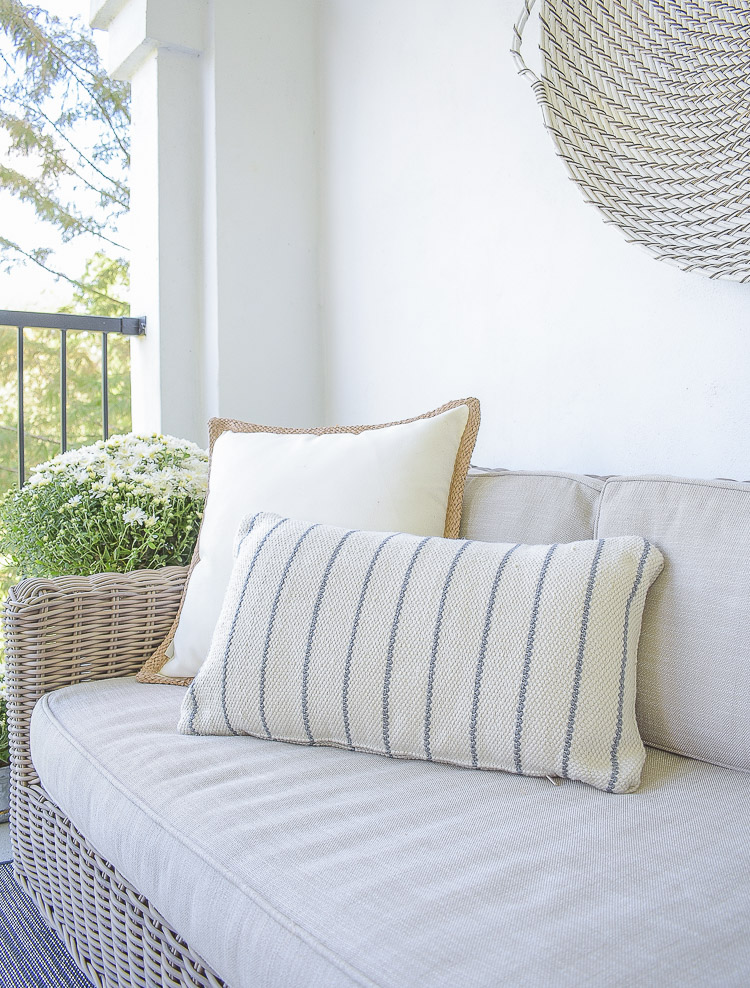 A Cozy Modern Fall Patio Tour - boho chic indoor outdoor pillow with texture