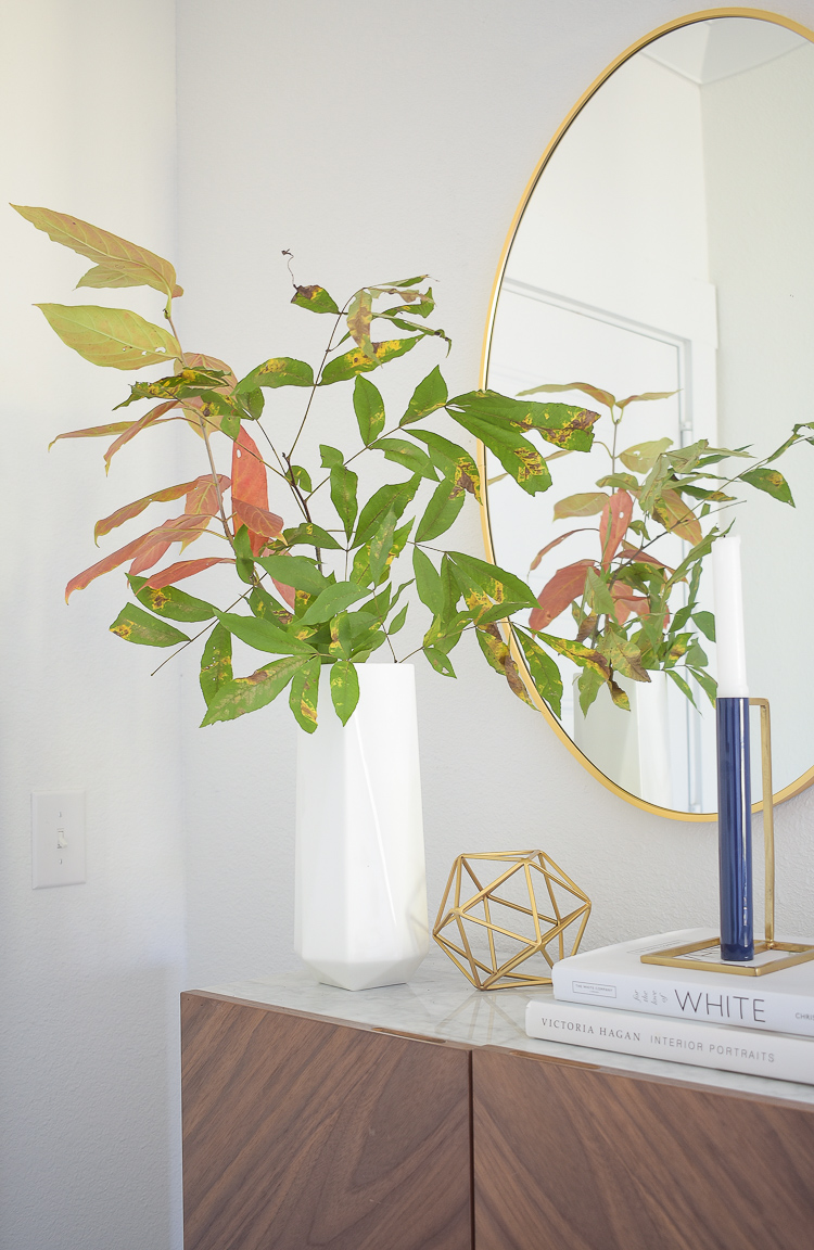 Chic Modern Styled Fall Entry - white geometric vase with fall outdoor clippings/branches