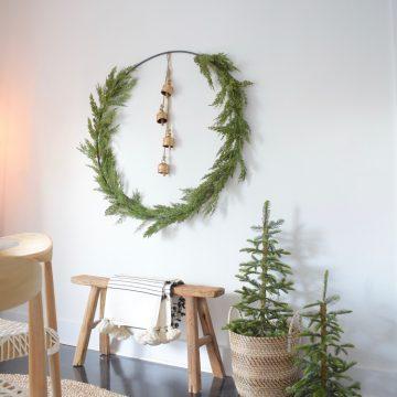 Gold bells inside christmas floral ring / wreath. Pre-lit table top tress. Best black friday deals