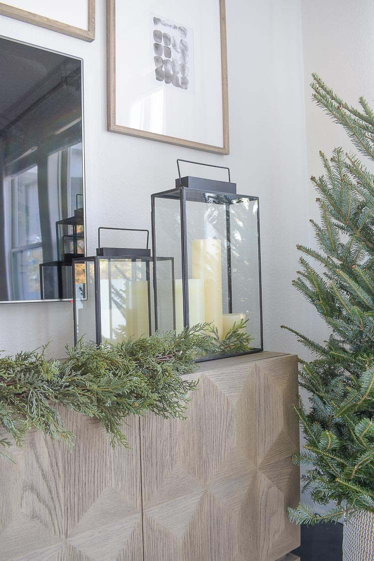 Black, white & gold modern Christmas living room tour - LED candles in modern black lanterns