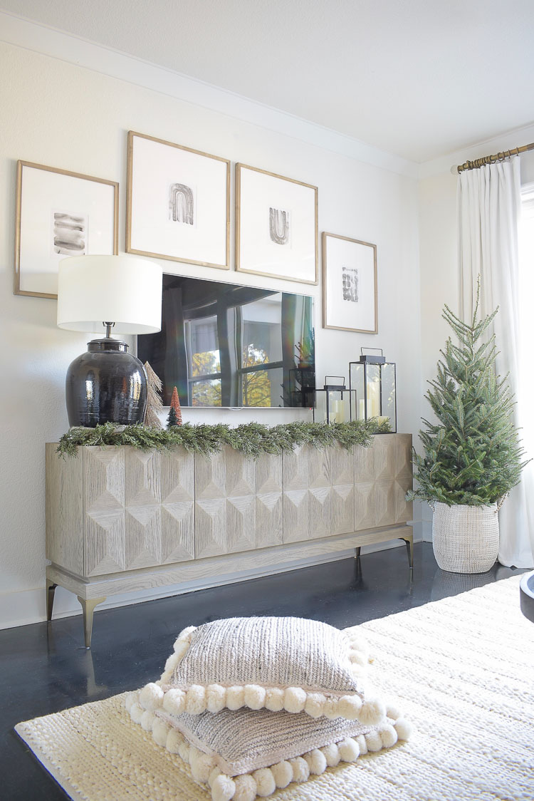 Black, white & gold modern Christmas living room tour - modern gallery wall styled for Christmas