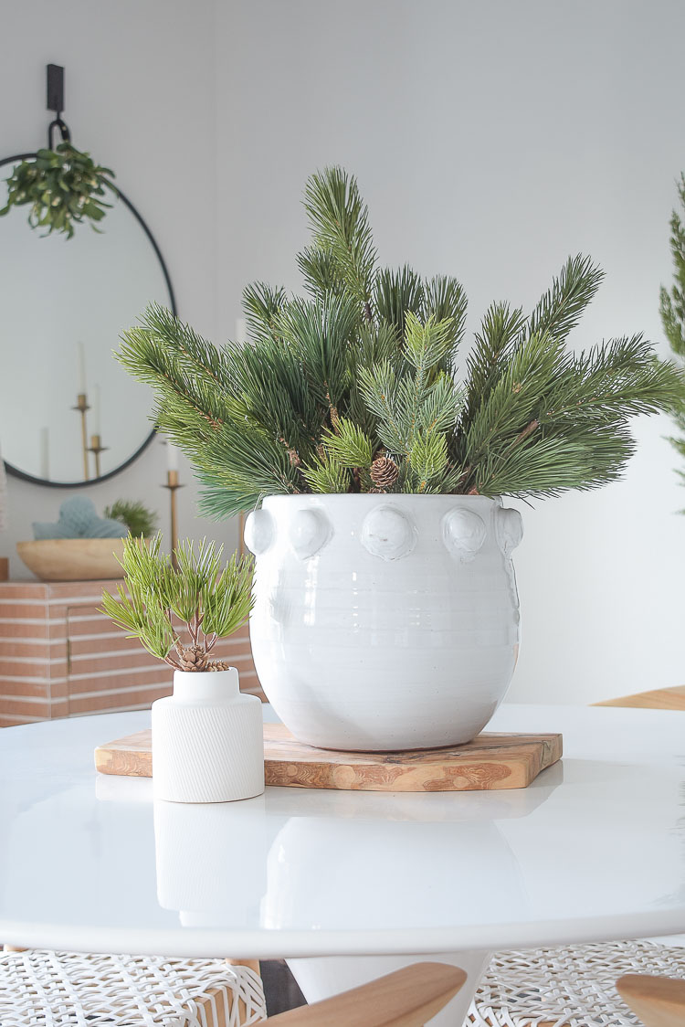 Christmas dining room tour - simple christmas centerpiece in white dotted pot