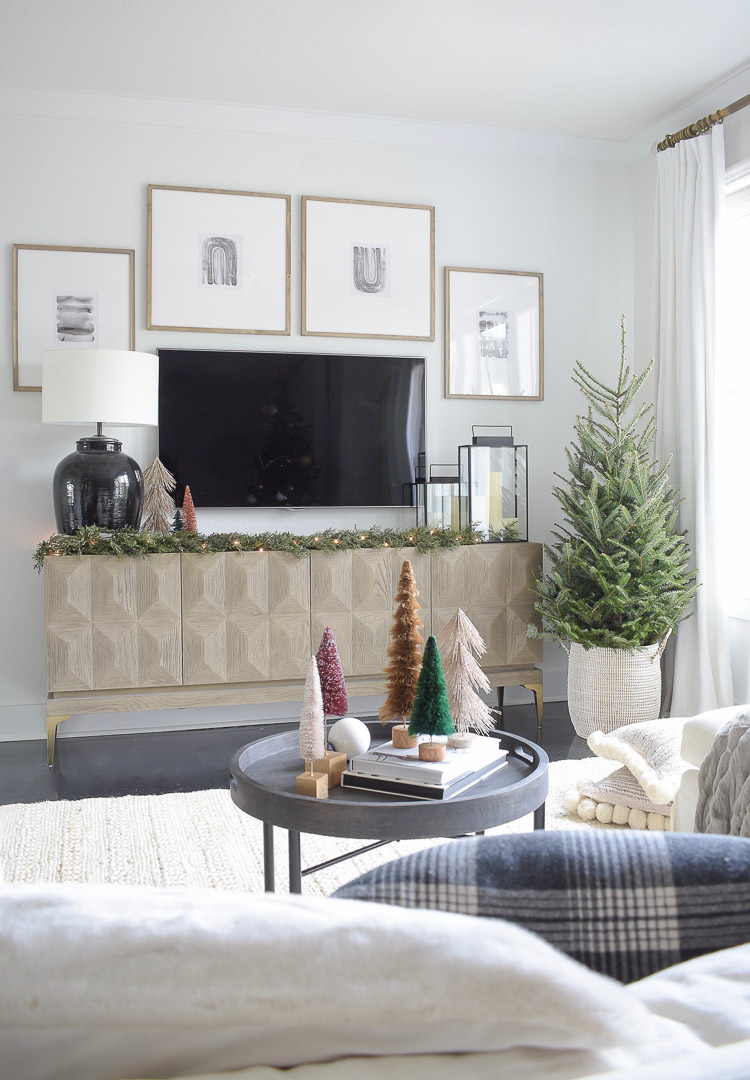 Black, white & gold modern Christmas living room tour - real christmas tree in basket