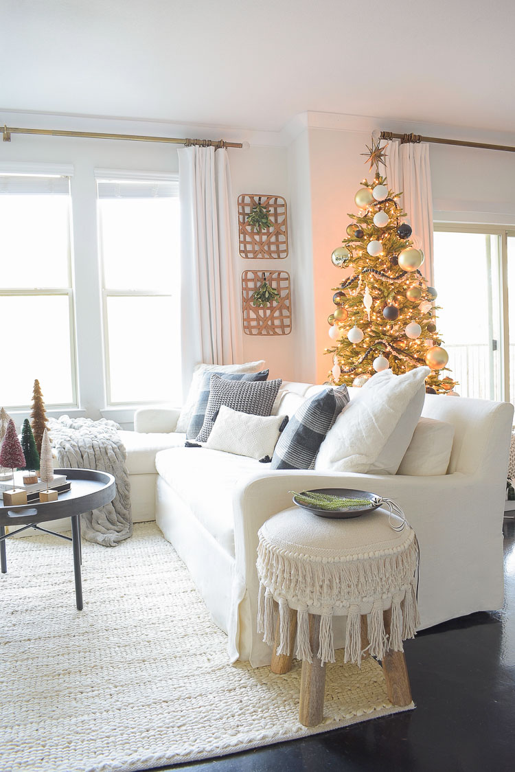 Black, white & gold modern Christmas living room tour - white sofa with Christmas themed pillows